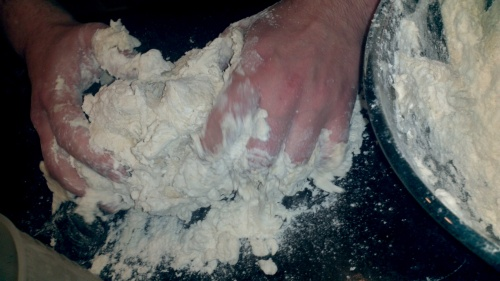 4.When you able to lift it, take the mixture out of the bowl and knead it some more