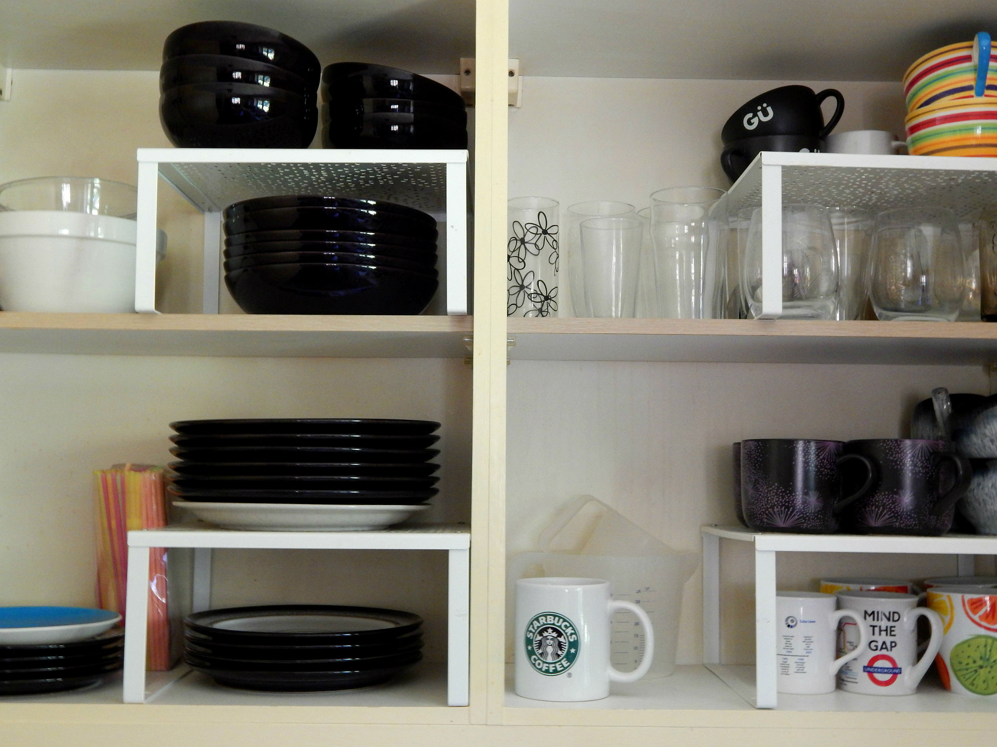 Kitchen storage solutions cupboard organizer raised for Kitchen shelves and cupboards